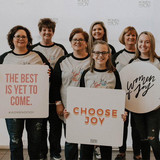 Women of Joy with signs